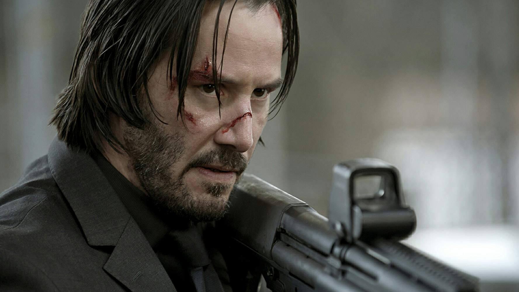 銃を撃ちまくるジョン・ウィック